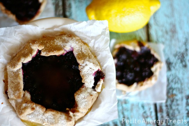 Gluten Free Triple Berry Galette- Bursting with blueberries, strawberries and raspberries this galette is a simple way to impress company. Vegan, egg free, dairy free