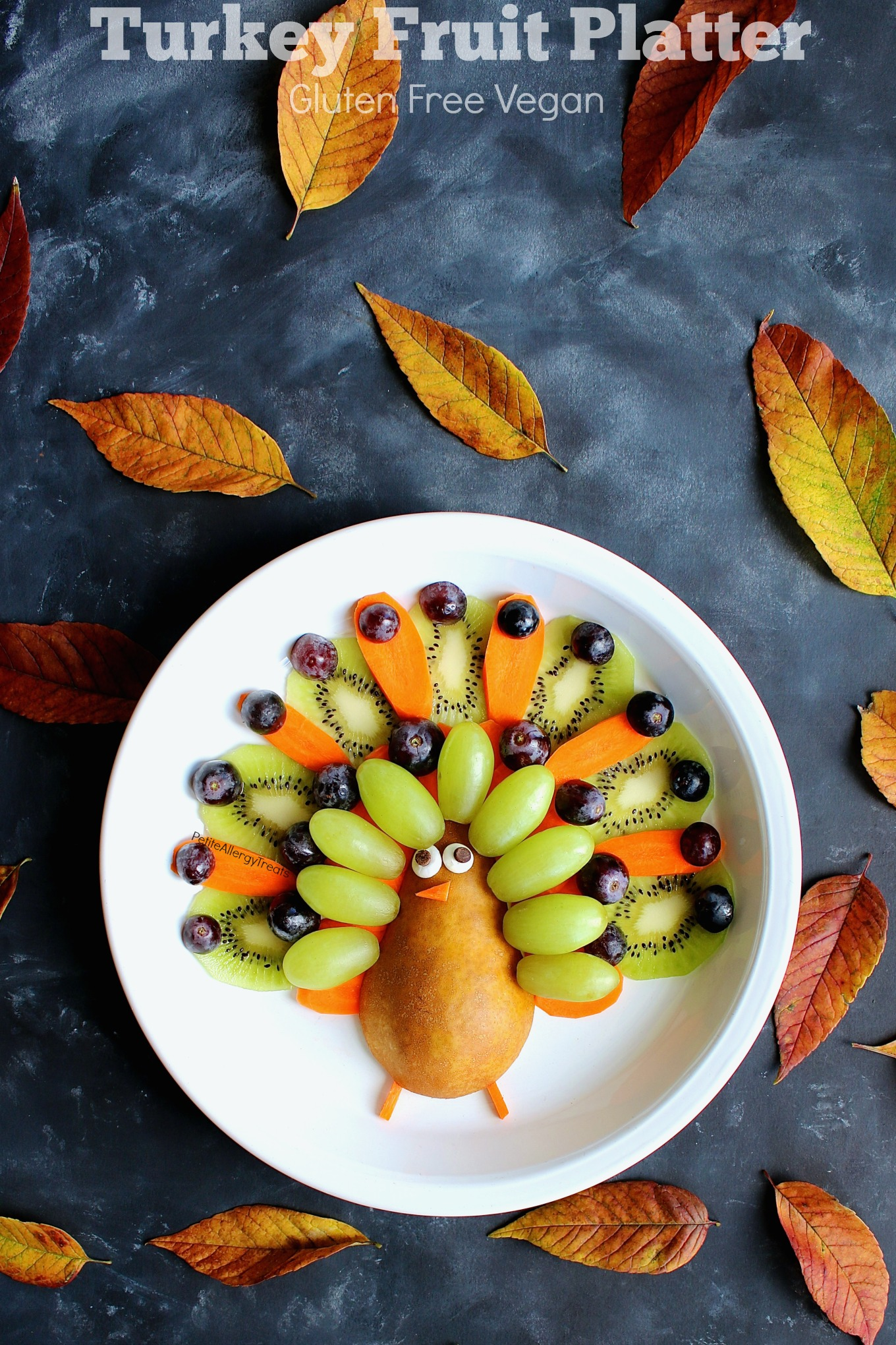 Vegan Turkey Fruit Platter (gluten free ) Recipe- Adorable easy Thanksgiving turkey fruit platter! Simple center piece for any fall party!