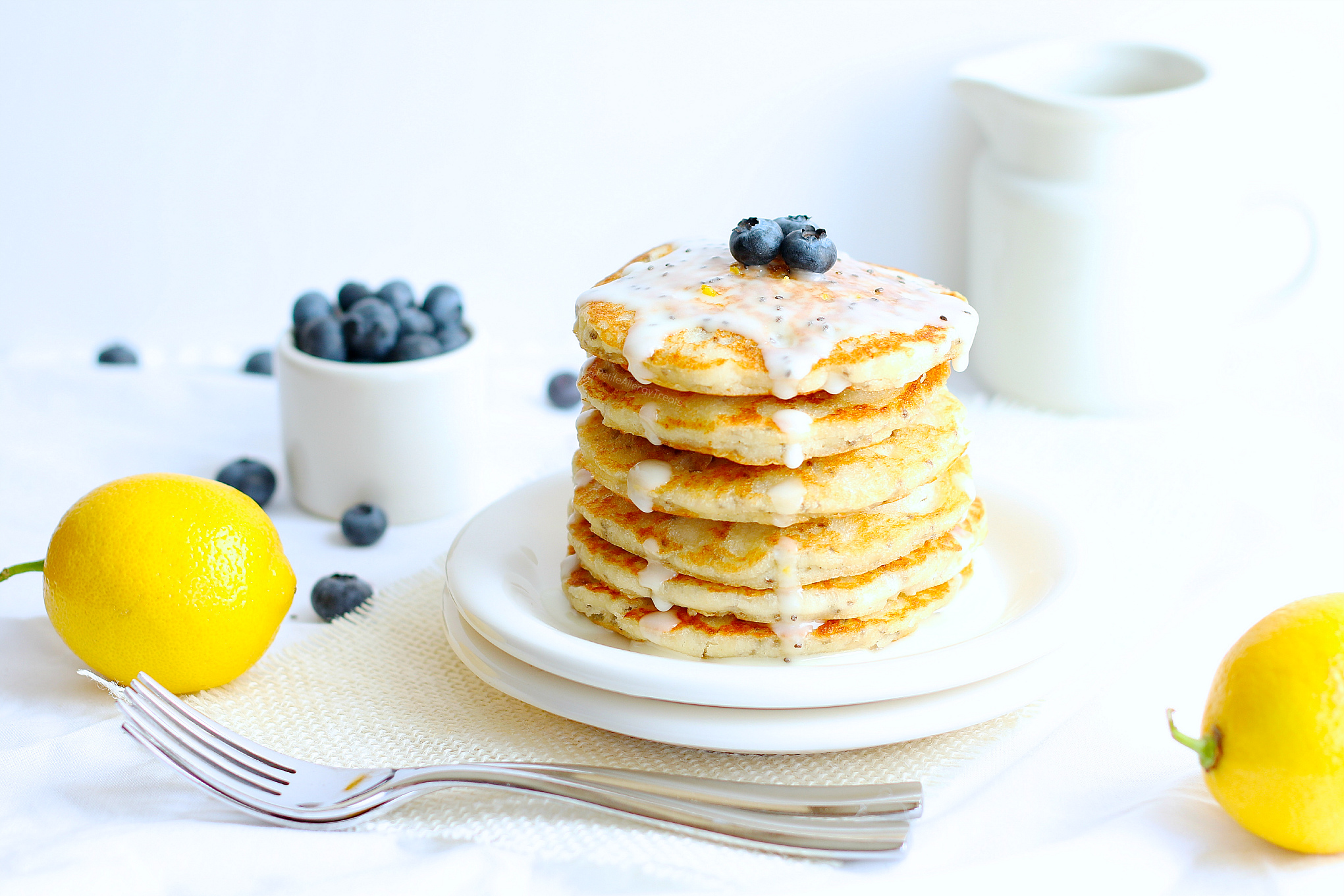 Vegan Lemon Pancakes (gluten free dairy free Vegan) recipe- Easy gluten free lemon chia pancakes, like lemon poppy seed pancakes but better. Super food allergy friendly too-egg free, dairy free and nut free. #glutenfree #dairyfree #eggfree